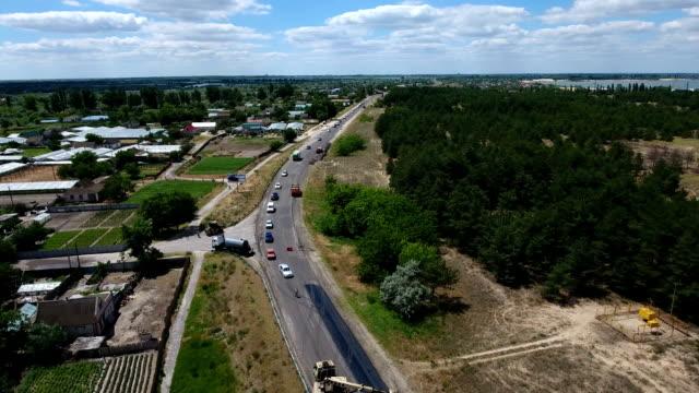 Aerial shot of a highway repairing, blacktopping, excavating, in summer video