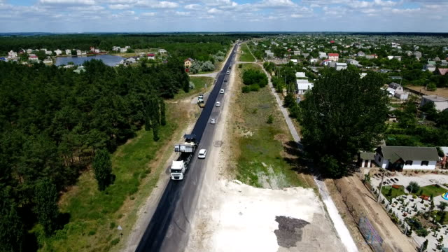 Aerial shot of a highway reparing with one black lane done in summer video