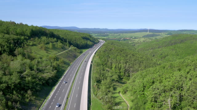 Aerial shot of a highway running through countryside video