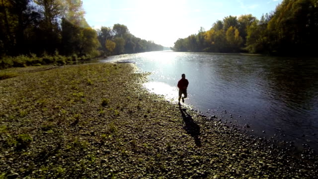 HD: Aerial Shot Of A Jogger By The River video