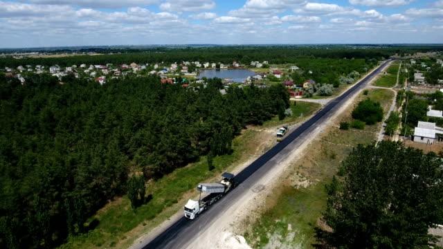 Aerial shot of a modern motorway reparing with one black lane done in summer video