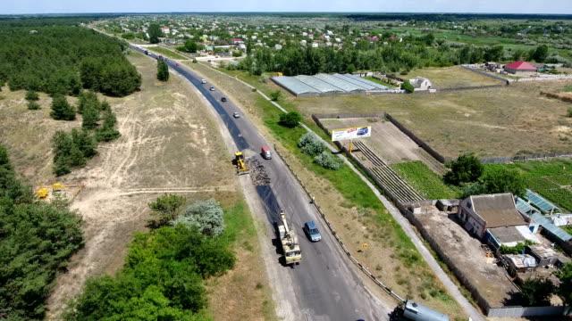 Aerial shot of a motorway blacktopping, excavating, and repairing in summer video