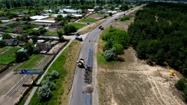 Aerial shot of a road blacktopping, excavating, and repairing in summer video