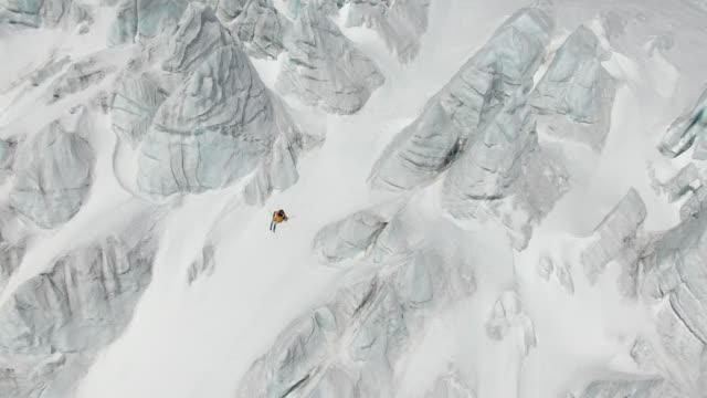 Aerial shot of a skier descending a mountainside in the Caucasus Mountains