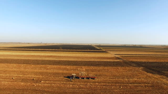 Aerial shot of a tractor on a farm field video