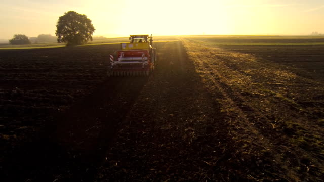 HD: Aerial Shot Of A Tractor Plowing The Field video