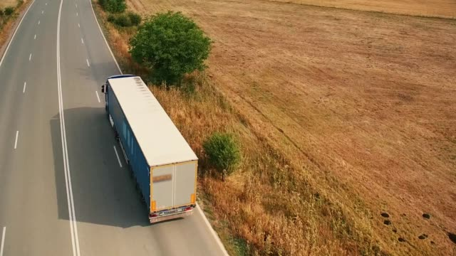Aerial Shot of a Trucks Driving Aerial Shot of a Trucks Driving semi truck stock videos & royalty-free footage