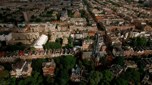 aerial shot of amsterdam with houses and volden church - dutch architecture stock videos & royalty-free footage