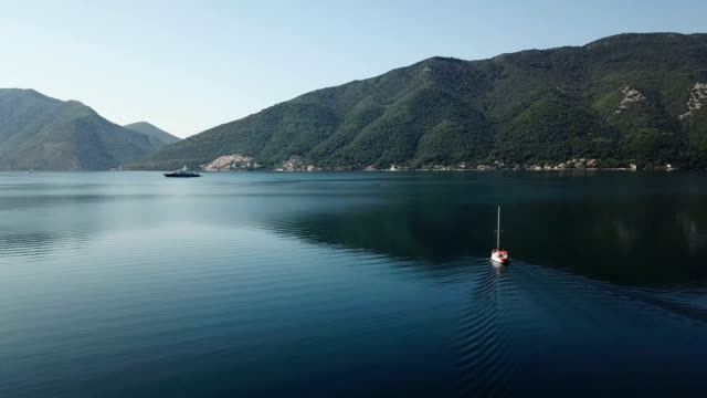 aerial shot of anchored sailboat in a bay - miroslav mitic stock videos and b-roll footage