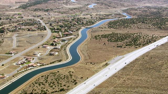 Aerial shot of aqueduct with freeway bridge  aqueduct stock videos & royalty-free footage
