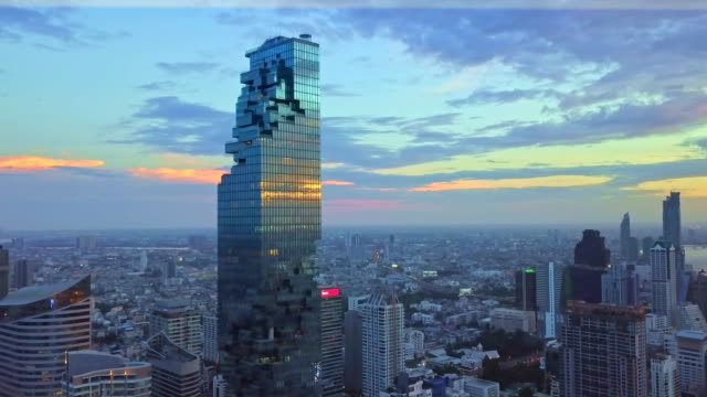 Aerial shot of Bangkok City, Silom/Sathon central business district with mahanakhon tower Aerial shot of Bangkok City, Silom/Sathon central business district at sunset bangkok stock videos & royalty-free footage