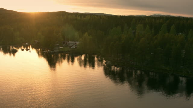 Aerial shot of beach house at sunset beach house, aerial, autumn, beautiful, beauty, bright, deforestation, drone, epic, estonia, europe, finland, flare, fog, forest, green, landscape, latvia, light, lithuania, morning, nature, norway, poland, road, sun, sunlight, sunrise, sunset, sunshine, sweden, top, travel, tree, view, woods, blackmagic pocket camera, holiday home, fisherman chalet stock videos & royalty-free footage