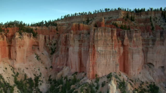 aerial shot of bryce canyon national park passing cliff face video