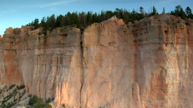 aerial shot of bryce canyon national park passing flat cliff video