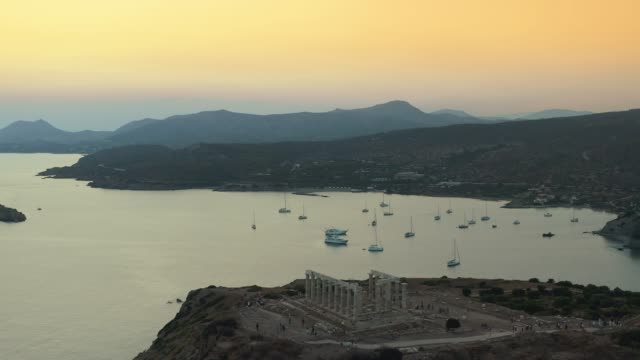 Aerial Shot of cape Sounio in Athens,Athens, Greece with the ancient Temple of Poseidon during the sunset at summer Aerial Shot of cape Sounio in Athens,Athens, Greece with the ancient Temple of Poseidon during the sunset at summer sounion stock videos & royalty-free footage