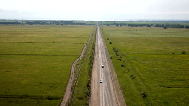 Aerial shot of car on the rural road video