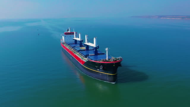 aerial shot of cargo floating in sea - nave cisterna video stock e b–roll