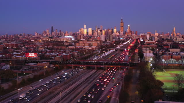 Aerial Shot of Chicago Cityscape and Rush Hour Traffic Aerial View of Chicago at Dusk - 2019 chicago stock videos & royalty-free footage