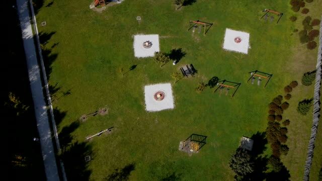 Aerial shot of children's playground, basketball and football court video