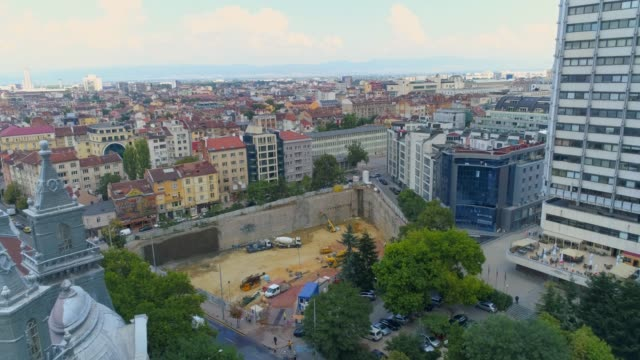 Aerial shot of city construction site in business district Sofia, Bulgaria Aerial shot of city construction site in business district Sofia, Bulgaria. The scene is situated in downtown district in Sofia, Bulgaria (Eastern Europe) during sunny day. The footage was shot on DJI Phantom 4 Pro drone. foundation make up stock videos & royalty-free footage