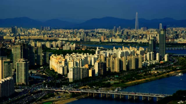 Aerial shot of city Seoul and Lotte world mall with traffic highway , South Korea video