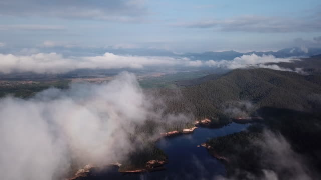 Aerial shot of cloud over the lake above the clouds