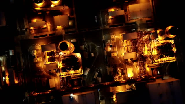 Aerial shot of combine cycle powerplant and cooling tower at night video