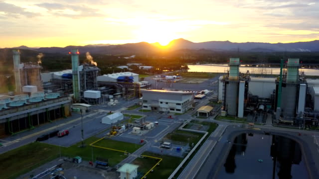 Aerial shot of combine cycle powerplant and cooling tower during sunset video