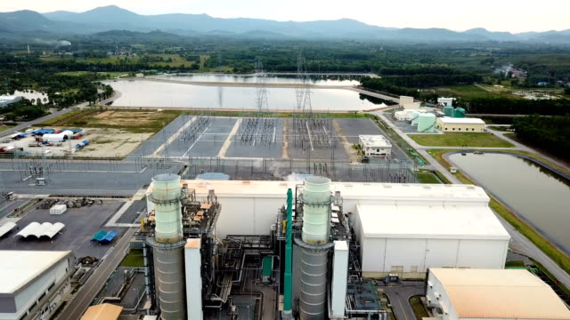 Aerial shot of combine cycle powerplant and cooling tower in Asia video