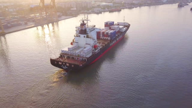 aerial shot of container ship export and import at dockyard for logistic and transport in ocean of south east asia - nave cisterna video stock e b–roll