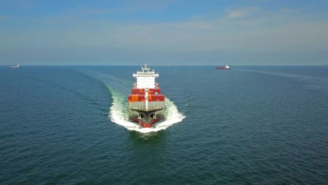 aerial shot of container ship in ocean. - nave cisterna video stock e b–roll