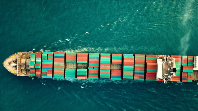 Aerial shot of container ship in ocean. Aerial shot of container ship in ocean commercial dock stock videos & royalty-free footage