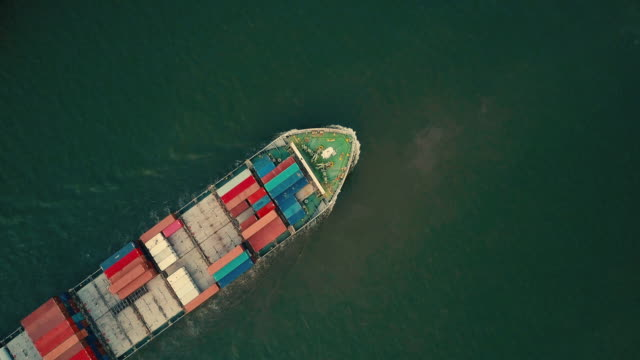 aerial shot of container ship in the sea - nave mercantile video stock e b–roll
