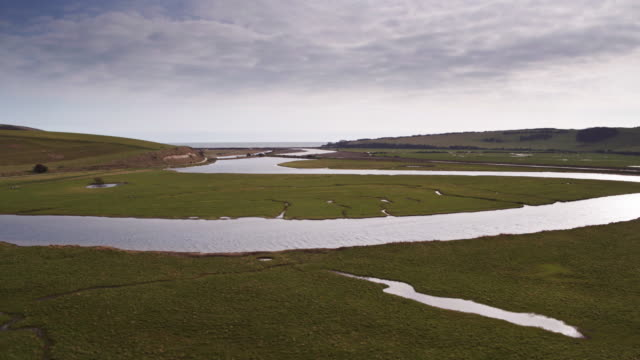 aerial shot of cuckmere haven, england - south downs video stock e b–roll