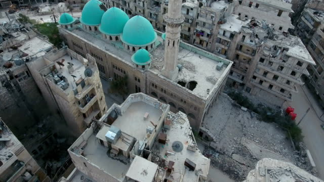 Aerial shot of demolished city building Aerial shot of demolished city building syria stock videos & royalty-free footage
