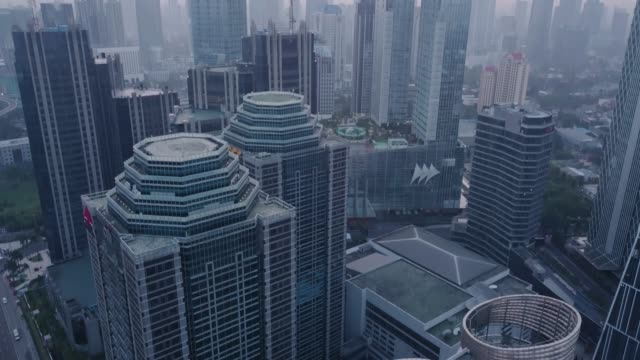 Aerial shot of Downtown Jakarta in the Morning Aerial drone shot of Downtown Jakarta in the Morning indonesia stock videos & royalty-free footage
