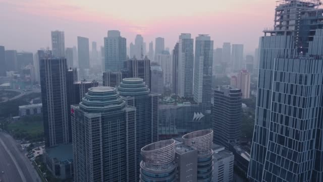 Aerial shot of Downtown Jakarta in the Morning Aerial drone shot of Downtown Jakarta in the Morning jakarta stock videos & royalty-free footage