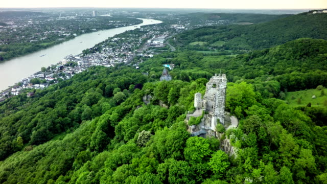 Aerial shot of Drachenfels in Siebengebirge Mountains , Germany Flyover Drachen Fels with Old Castle in the Siebengebirge mountain range in Germany. Rhine River with Bonn city in the background. fort stock videos & royalty-free footage