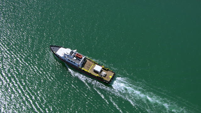 Aerial shot of fishing boat in ocean video