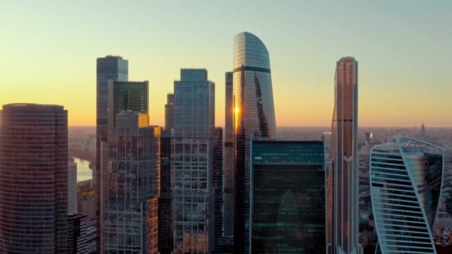 Aerial shot of futuristic Moscow International Business Center at sunset. Financial district skyscrapers. The concept of success. the camera is going backwards