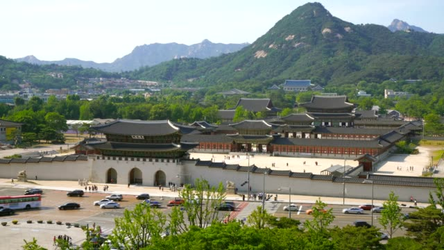 Aerial shot of Gyeongbokgung palace and the Blue House , Seoul, South Korea Shot with Sony FS7 gwanghwamun gate stock videos & royalty-free footage