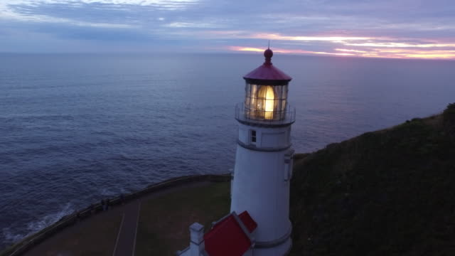 Aerial shot of Heceta Head Lighthouse at sunset