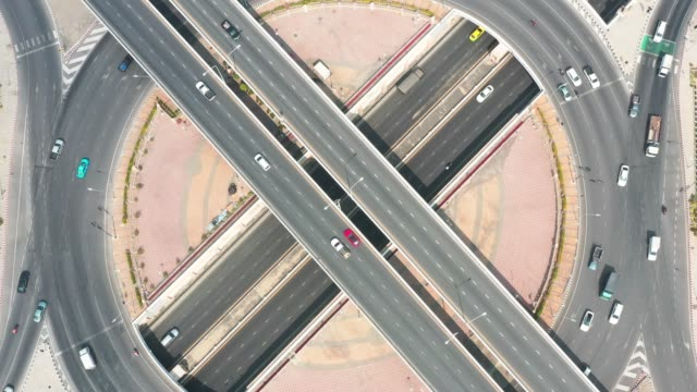 Aerial shot of highway intersection during rush hour.Transportation and traffic in the big city