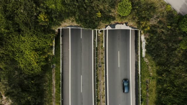 Aerial shot of highway tunnel in mountains Aerial view of highway tunnel in mountains tunnel stock videos & royalty-free footage