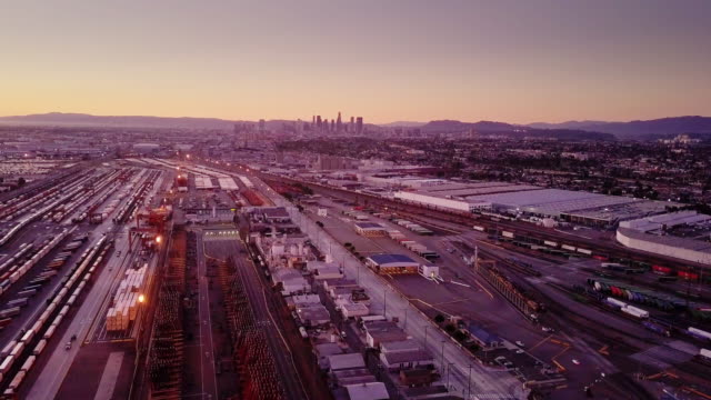 Aerial Shot of Intermodal Rail Yard With Downtown Los Angeles Skyline video