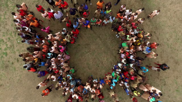 aerial shot of kenyan adults and children - bambine africa video stock e b–roll