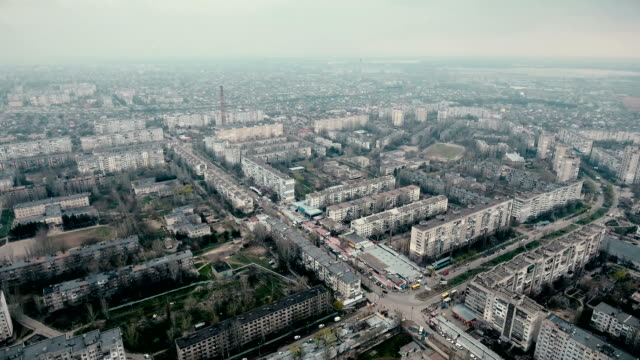 Aerial shot of Kherson city with its  modern buildings and highway