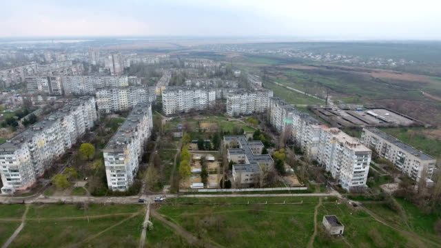 Aerial shot of Kherson city with its  multistoreyed buildings and city road