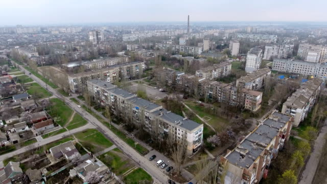 Aerial shot of Kherson city with its  multistoreyed buildings and highway