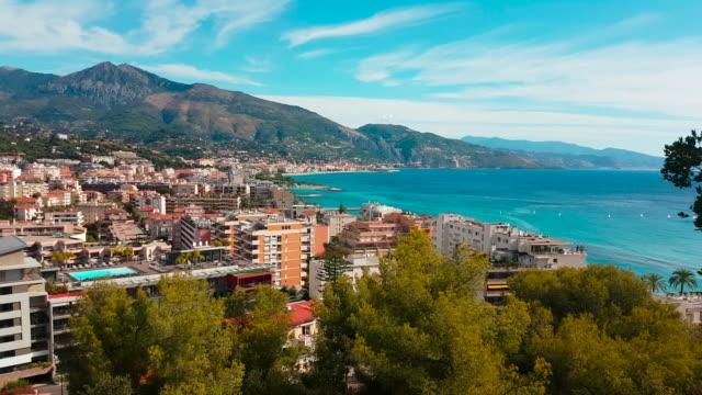 Aerial Shot of Mediterranean Resort City Timelapse of Roquebrune-Cap-Martin. Aerial Shot of Mediterranean Resort City. Popular Summer Resort in France - 4K Video nice france stock videos & royalty-free footage